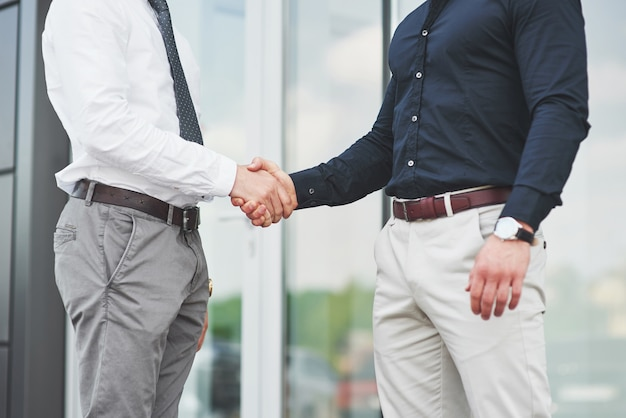 Handshake of two men. successful business contacts after a good deal.