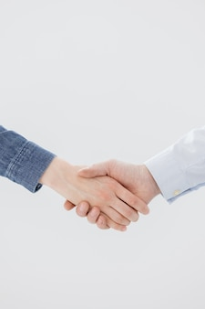 A handshake of two people a man and a woman business partners greet