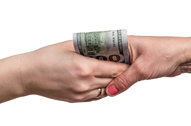 Handshakes with dollar banknotes in hands .
