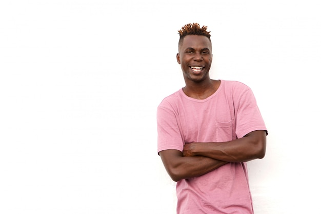 Handsome african american man with arms crossed standing on white background