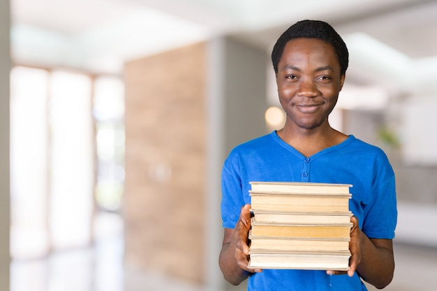 Handsome african american man with books