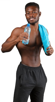 Handsome african american man with towel isolated on white