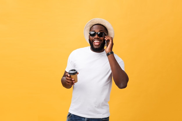Handsome african american with mobile phone and take away coffee cup.