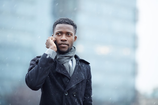 Handsome african man on phone in street