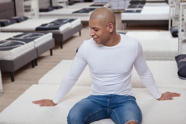 Handsome african man shopping at home furniture store