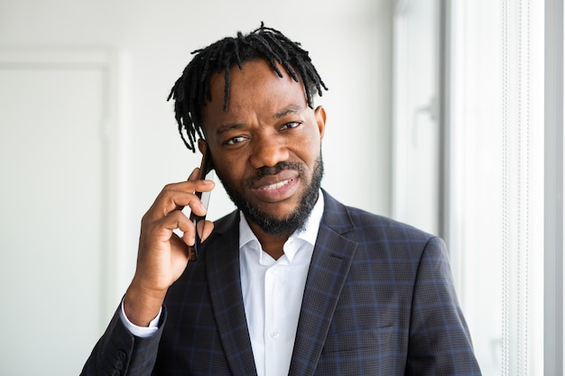 Handsome african man with mobile phone