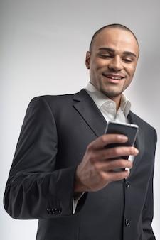 Handsome afro businessman using his smartphone portrait