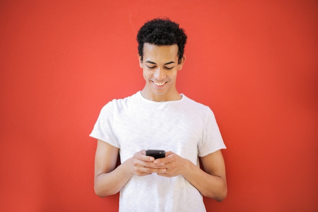 Handsome afro guy texting