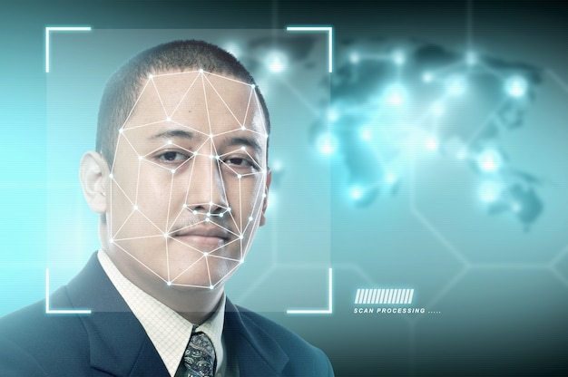 Handsome asian businessman using face recognition