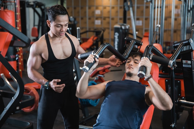 Handsome asian male doing chest exercises