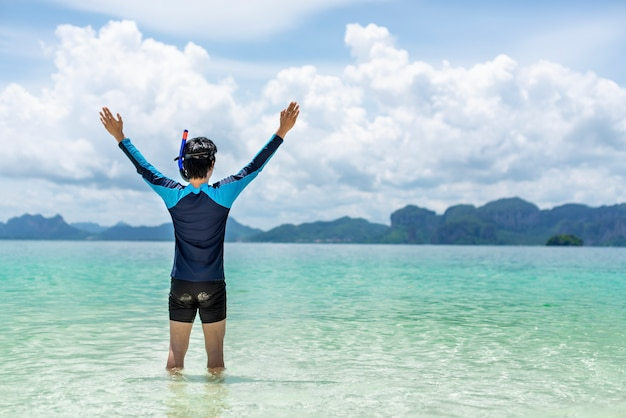 Handsome asian man enjoying a holiday on the sea shore,concept of summer