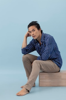 Handsome asian man posing