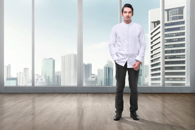 Handsome asian muslim man with hand on pocket standing