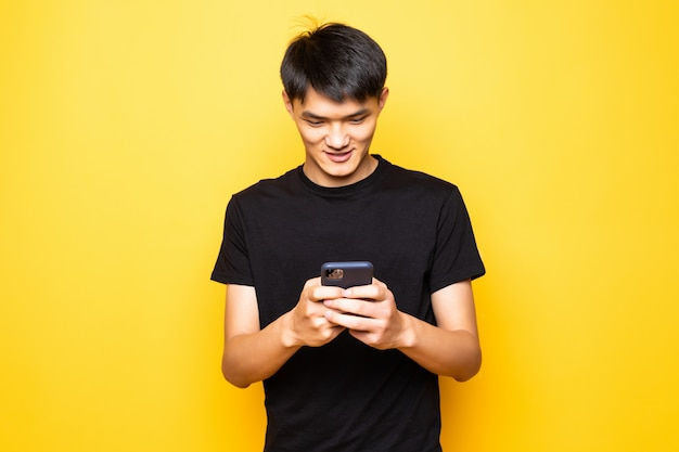 Handsome asian young man using smartphone