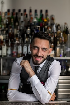 Handsome barkeeper working at counter