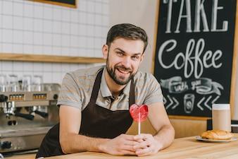 Handsome bartender with lollipop