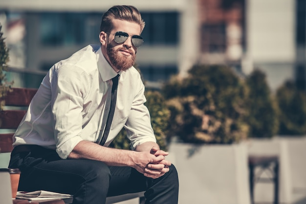 Handsome bearded businessman in classic shirt.