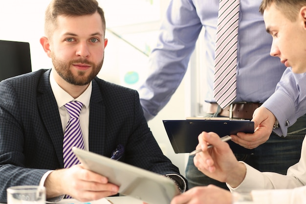 Handsome bearded businessman in suit and tie during meeting