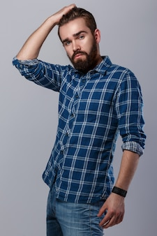 Handsome bearded man in checkered shirt