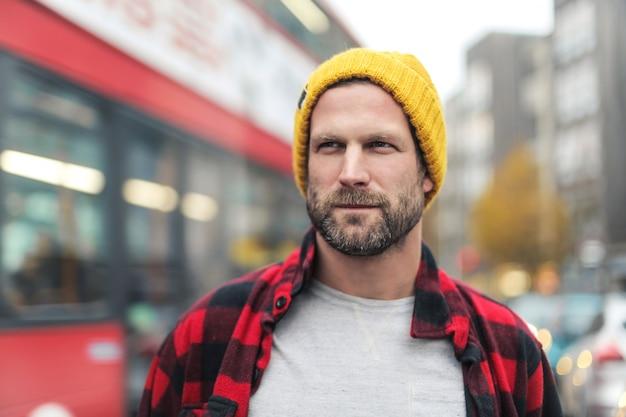 Handsome bearded man walking in the street of london