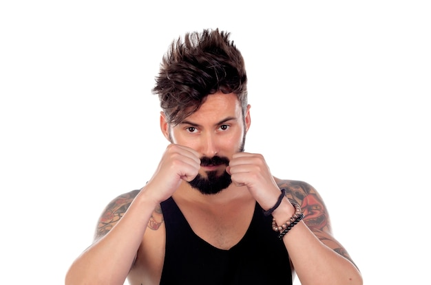 Handsome bearded man with tattoos showing the fists