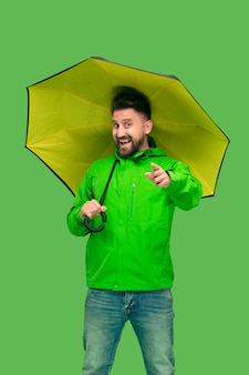 Handsome bearded young man holding umbrellaisolated on white