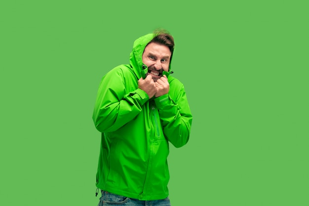 Handsome bearded young man isolated on green
