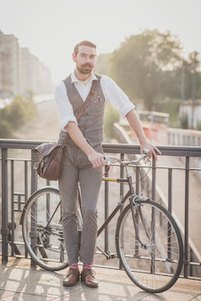 Handsome big moustache hipster man with bicycle