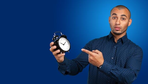Handsome black man holding vintage clock