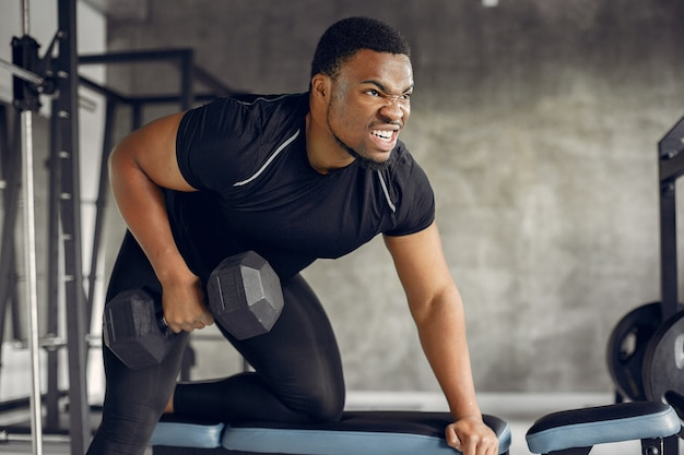 A handsome black man is engaged in a gym
