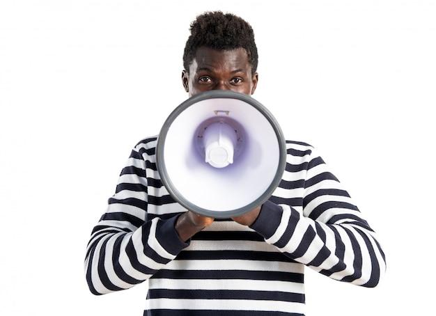 Handsome black man shouting by megaphone