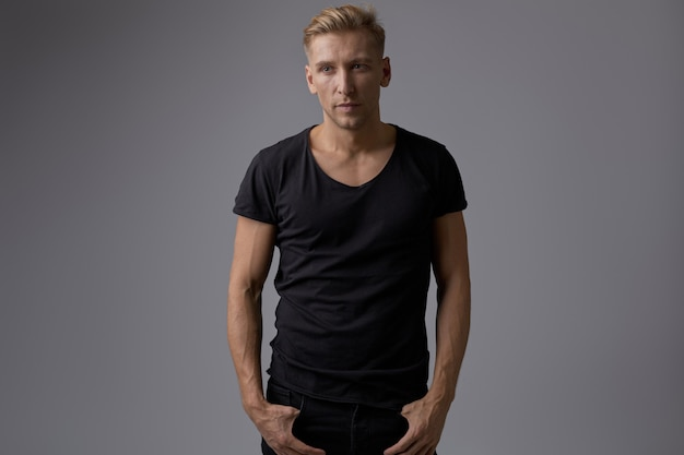 Handsome blond young man posing