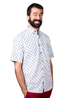 Handsome brunette man with beard winking