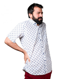 Handsome brunette man with beard with back pain
