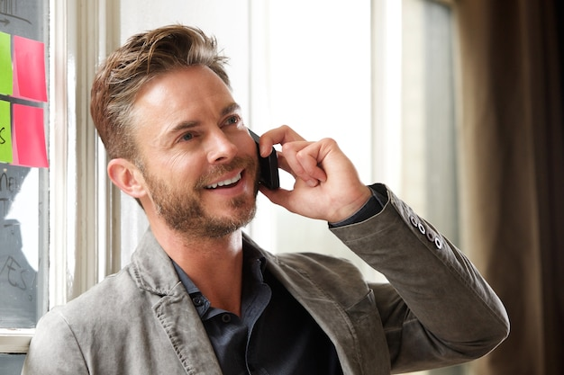 Handsome business casual man talking on phone