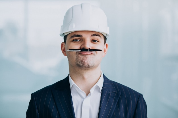 Handsome business man engineer in hard hat in a building