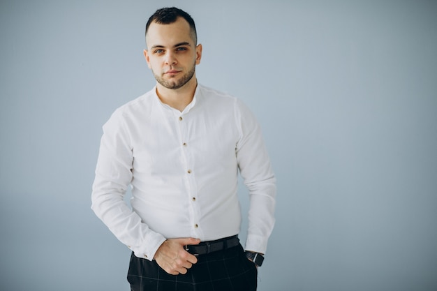 Handsome business man in white shirt isolated in office