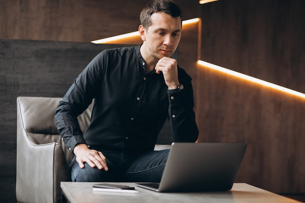 Handsome business man working on computer in office
