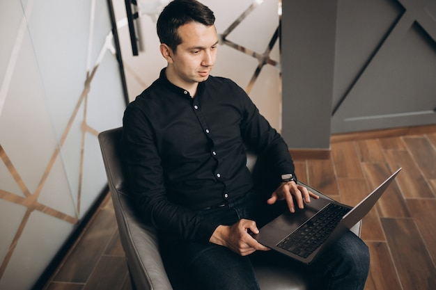 Handsome business man working with tablet in office