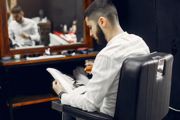 Handsome businessman in a barbershop