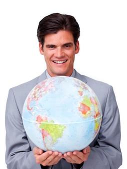 Handsome businessman holding a terrestrial globe