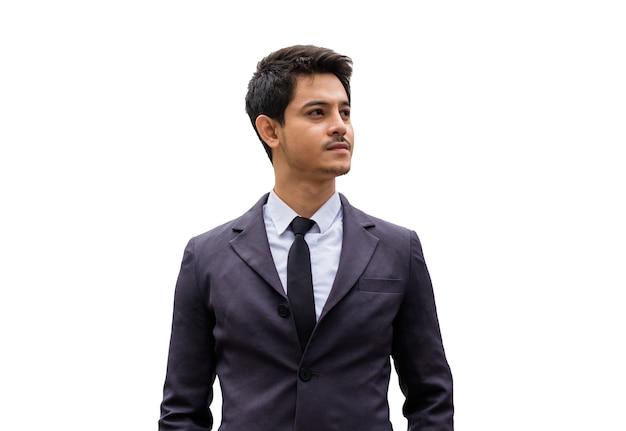 ハンサムなビジネスマンスマートで真剣に白い背景の上のネクタイとスーツを着て
