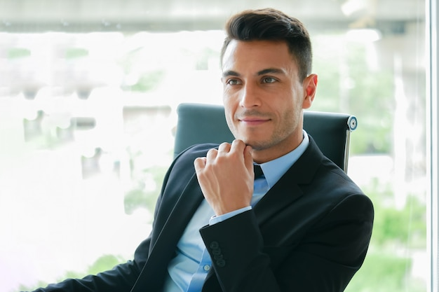 Handsome businessman thinking expression on break relax time in office