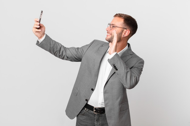 Handsome businessman using his smart phone