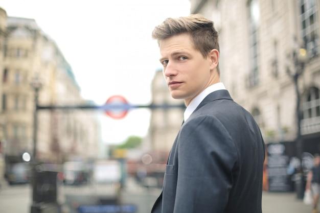 Handsome businessman walking in the street in london