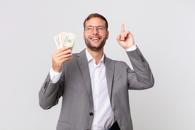 Handsome businessman with dollar banknotes