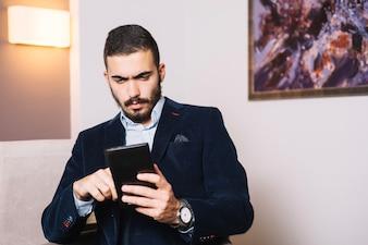 Handsome businessman with tablet