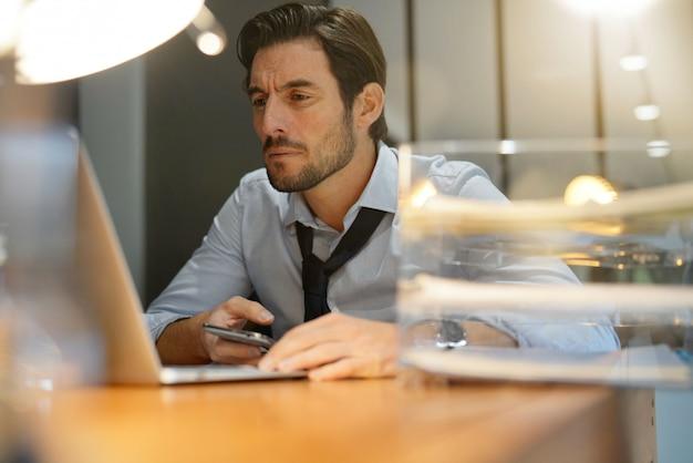 Handsome businessman working late modern office