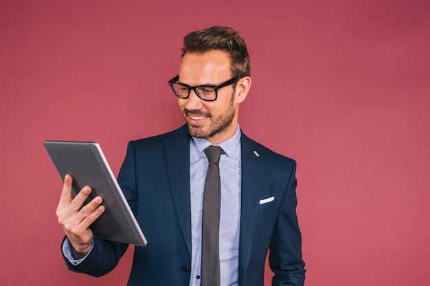Handsome businessman working in a tablet