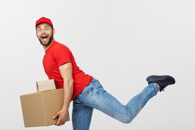 Handsome caucasian delivery man rush running for delivering a package for customer.